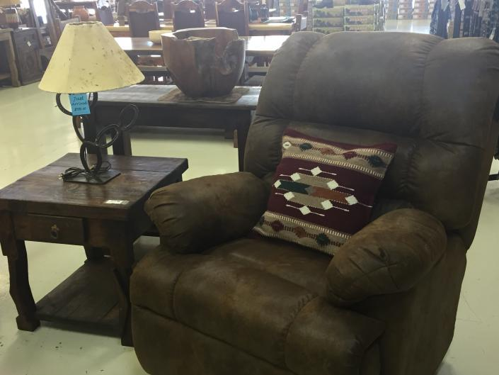 leather recliner and side table with horseshoe lamp